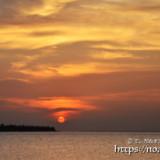 太陽と赤く染まる雲
